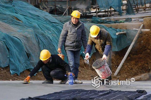 китайские рабочие на строительстве дорог в Китае